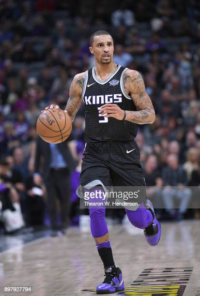 George Hill of the Sacramento Kings dribbles the ball against the Phoenix Suns during an NBA basketball game at Golden 1 Center on December 12 2017...