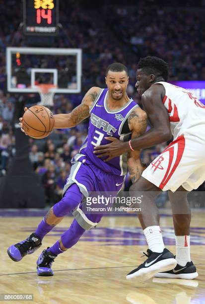 George Hill of the Sacramento Kings drives towards the basket on Clint Capela of the Houston Rockets during an NBA basketball game at Golden 1 Center...
