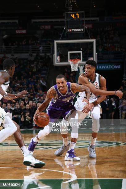 George Hill of the Sacramento Kings handles the ball against Giannis Antetokounmpo of the Milwaukee Bucks on December 2 2017 at the BMO Harris...