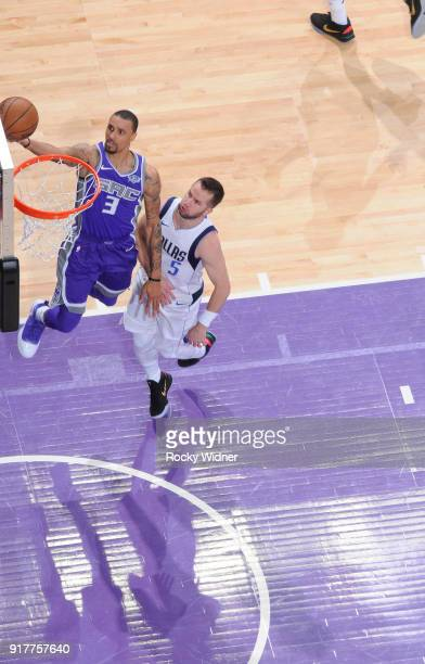George Hill of the Sacramento Kings shoots a layup against JJ Barea of the Dallas Mavericks on February 3 2018 at Golden 1 Center in Sacramento...