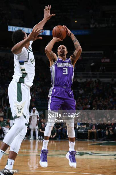 George Hill of the Sacramento Kings shoots the ball against the Milwaukee Bucks on December 2 2017 at the BMO Harris Bradley Center in Milwaukee...