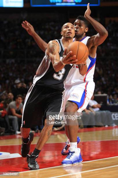 George Hill of the San Antonio Spurs drives against Ryan Gomes of the Los Angeles Clippers during a preseason game on October 12 2010 at the Palacio...