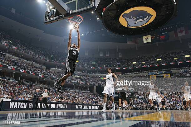 George Hill of the San Antonio Spurs dunks against the Memphis Grizzlies in Game Four of the Western Conference Quarterfinals in the 2011 NBA...