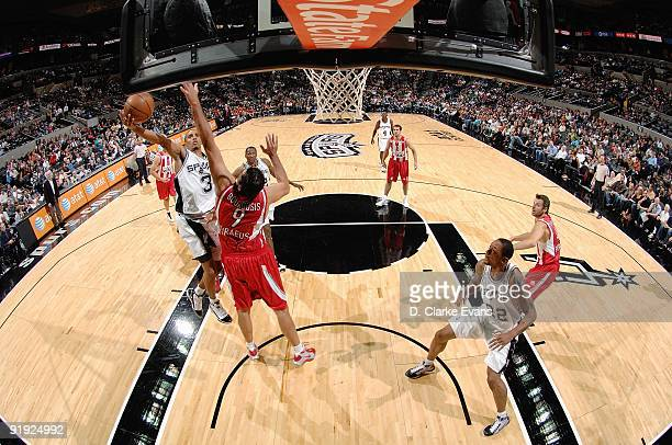 George Hill of the San Antonio Spurs lays up a shot against Ioannis Bourousis of the Greece Olympiacos during the exhibition game on October 9 2009...