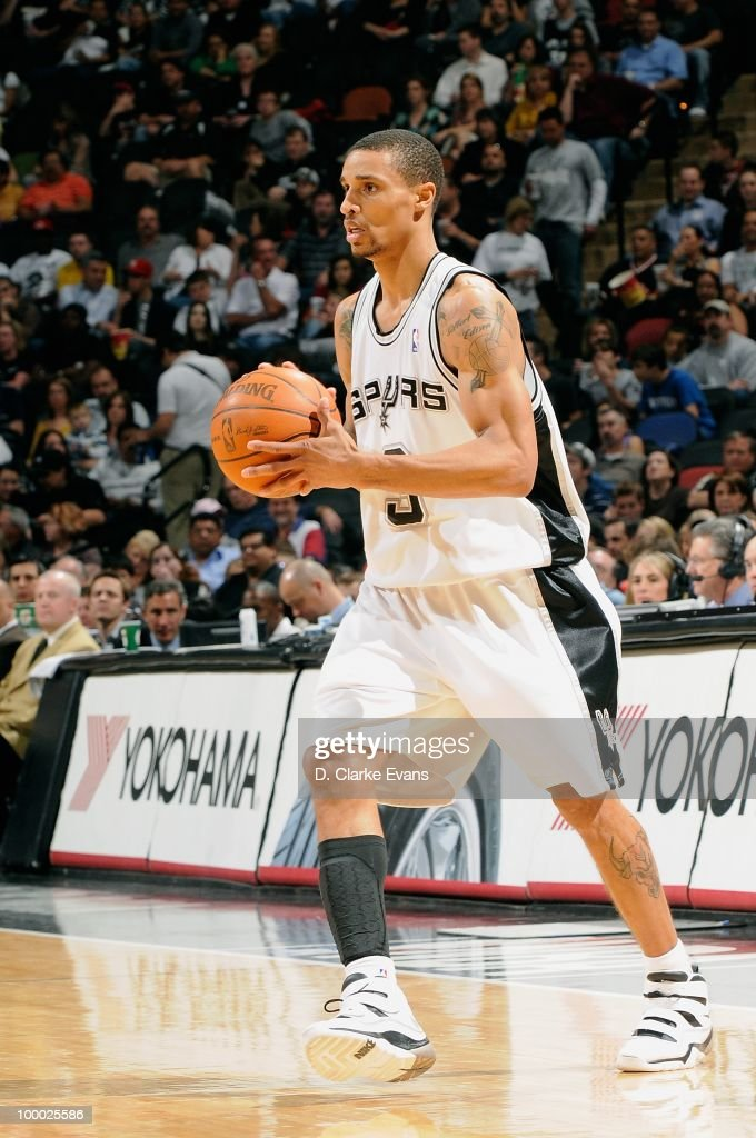 George Hill #3 of the San Antonio Spurs moves the ball against the Los Angeles Clippers during the game on March 13, 2010 at the AT&T Center in San Antonio, Texas. The Spurs won 118-88.