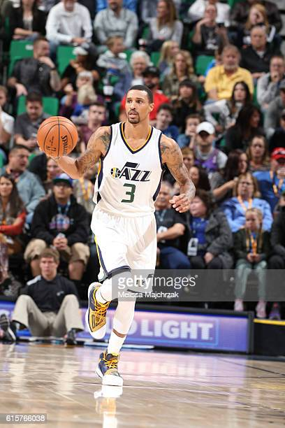 George Hill of the Utah Jazz brings the ball up court against the Portland Trail Blazers on October 19 2016 at vivintSmartHome Arena in Salt Lake...
