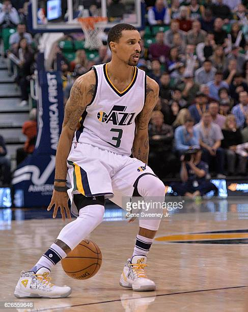 George Hill of the Utah Jazz controls the ball in the second half of their 120101 win over the Houston Rockets at Vivint Smart Home Arena on November...