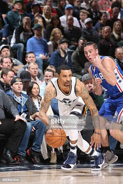 George Hill of the Utah Jazz handles the ball against the Philadelphia 76ers during the game on December 29 2016 at vivintSmartHome Arena in Salt...