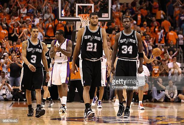 George Hill Tim Duncan and Antonio McDyess of the San Antonio Spurs react as Amar'e Stoudemire and the Phoenix Suns celebrate in the final moments of...