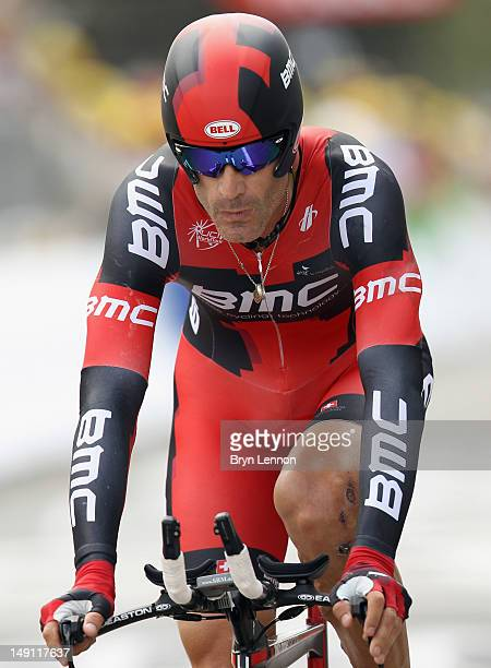 George Hincapie of the USA and BMC Racing Team crosses the finish line during stage nineteen of the 2012 Tour de France a 535km time trial from...