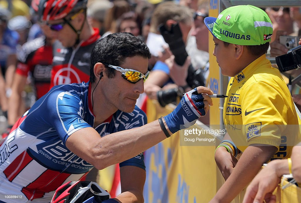 George Hincapie of the USA and riding for BMC Racing signs a jersey for a young fan before the start of Stage Eight of the 2010 Tour of California on May 23, 2010 in Thousand Oaks, California.