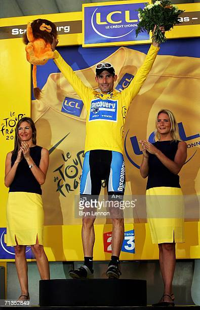 George Hincapie of the USA and the Discovery Channel team celebrates taking the yellow jersey after the first stage of the 2006 Tour de France from...