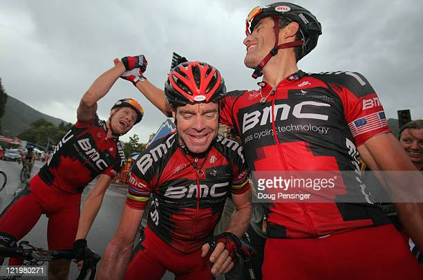 George Hincapie of the USA riding for BMC Racing celebrates his victory with teammate Cadel Evans of Australia and Jeff Louder of the USA in stage...