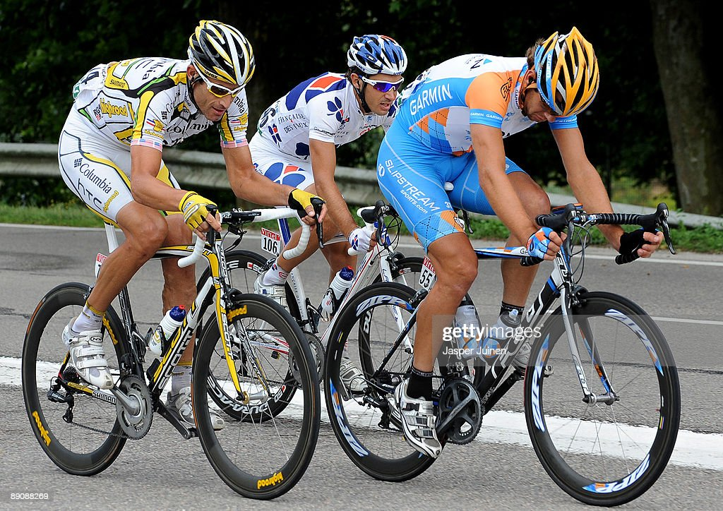 George Hincapie (L) of USA and team Colombia - High Road rides with Martijn Maaskant (R) and team Garmin - Slipstream and Christophe Le Mevel of France and team Francaise des Jeux in the break away during stage 14 of the 2009 Tour de France from Colmar to Besancon on July 18, 2009 in Besancon, France. Hincapie cycled to the third place in the overall standings in stage 14 trailing 5 seconds behind the yellow jersey.