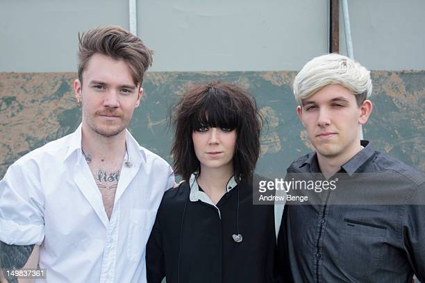 George Hinton, Sarah McIntosh and Hamish McIntosh of The Good Natured pose backstage during Y Not Festival which takes place in the Peak District on...