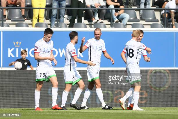 George Hirst of OH Leuven celebrates with his team mates after scoring to make it 10 during the Proximus League match between OH Leuven and Beerschot...
