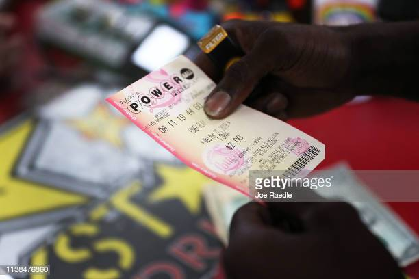 George Hollins buys a Powerball ticket at the Shell Gateway store on March 26, 2019 in Boynton Beach, Florida. Wednesday's Powerball drawing will be...