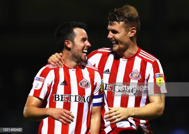 George Honeyman and Max Power of Sunderland celebrate after the full time whistle during the Sky Bet League One match between Gillingham and...