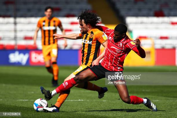 George Honeyman of Hull City and Brennan Johnson of Lincoln City during the Sky Bet League One match between Lincoln City and Hull City at Sincil...