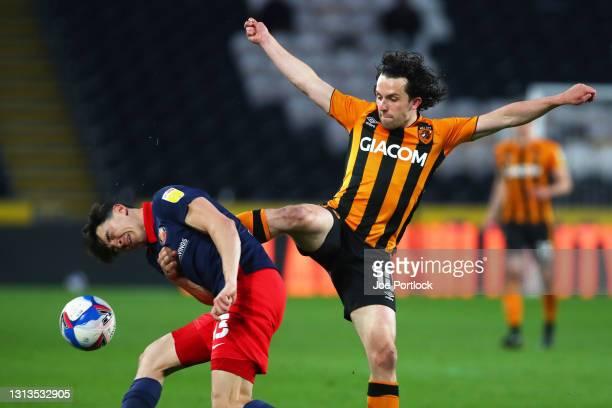 George Honeyman of Hull City fouls Luke O'Nien of Sunderland during the Sky Bet League One match between Hull City and Sunderland at KCOM Stadium on...