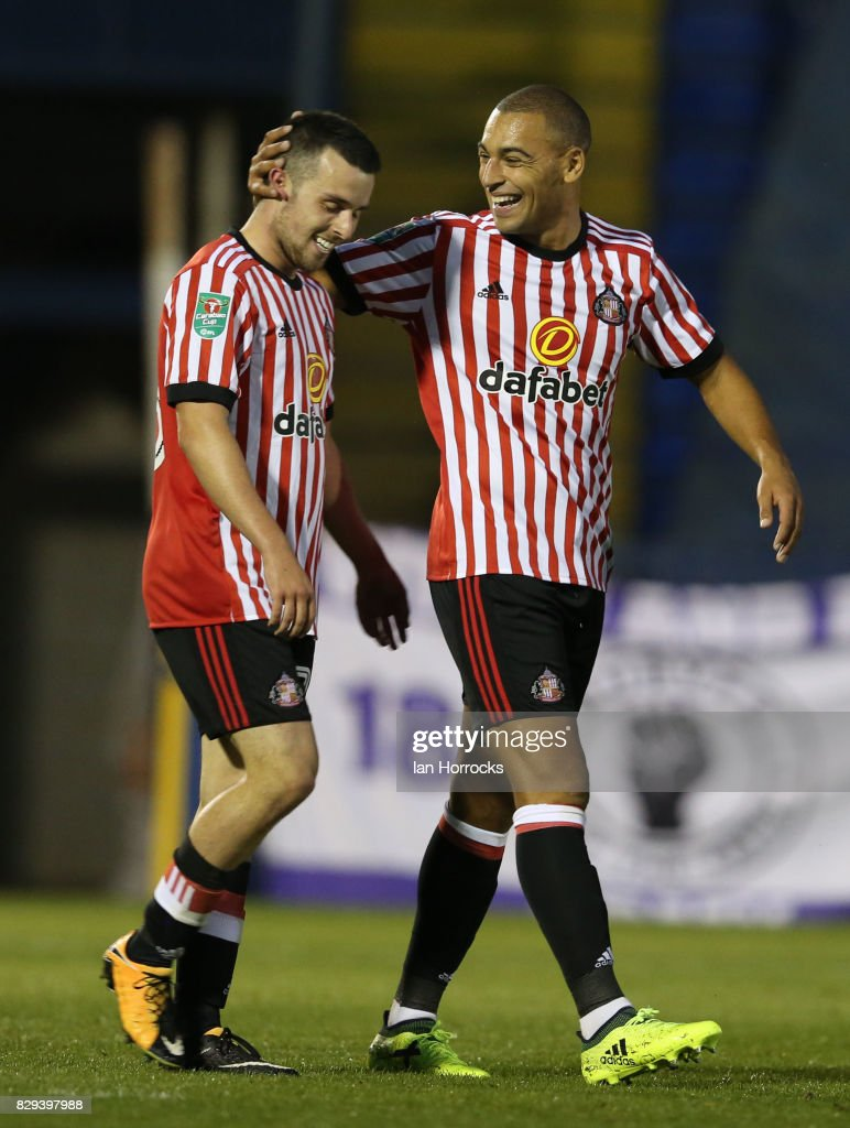 George Honeyman of Sunderland (L) celebrates after he scores the opening goal during the Carabao Cup First Round match between Bury and Sunderland at Gigg Lane on August 10, 2017 in Bury, England.