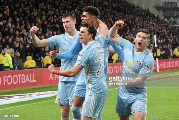George Honeyman of Sunderland celebrates scoring the opening goal with teammates during the Sky Bet Championship match between Derby County and...