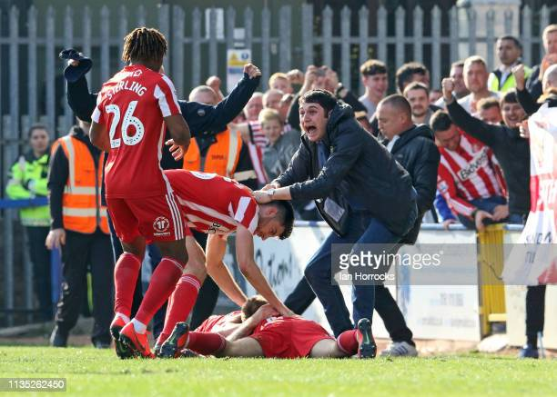 George Honeyman of Sunderland celebrates with players and fans after he scores the winning goal during the Sky Bet League One match between Rochdale...