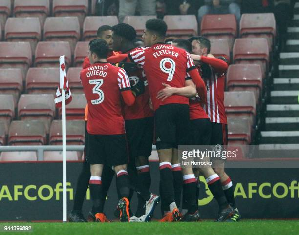 George Honeyman of Sunderland celebrates with teammates after he scores the opening goal during the Sky Bet Championship match between Sunderland and...