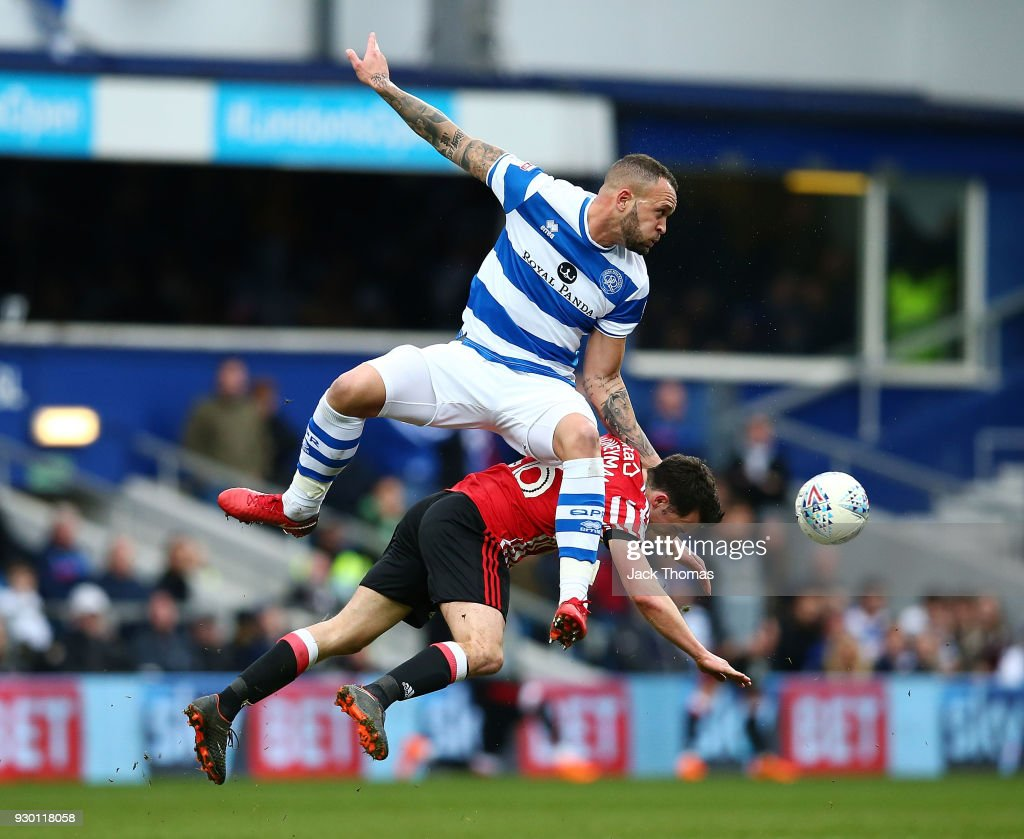 George Honeyman of Sunderland Joel Lynch of QPR compete for the ball during the Sky Bet Championship match between Queens Park Rangers and Sunderland at Loftus Road on March 10, 2018 in London, England.