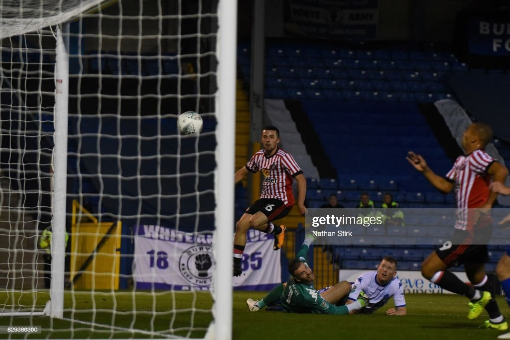 George Honeyman of Sunderland scores the first goal during the Carabao Cup First Round match between Bury and Sunderland at Gigg Lane on August 10, 2017 in Bury, England.