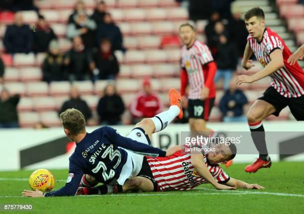George Honeyman of Sunderland tackles George Saville of Millwall during the Sky Bet Championship match between Sunderland and Millwall at the Stadium...
