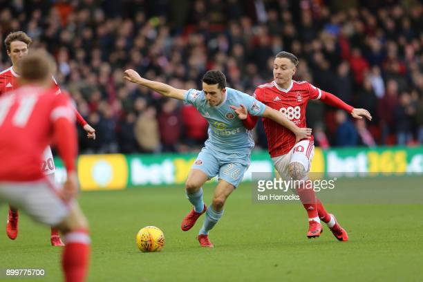 George Honeyman of Sunderland takes on Barrie McKay of Forest during the Sky Bet Championship match between Nottingham Forest and Sunderland at City...