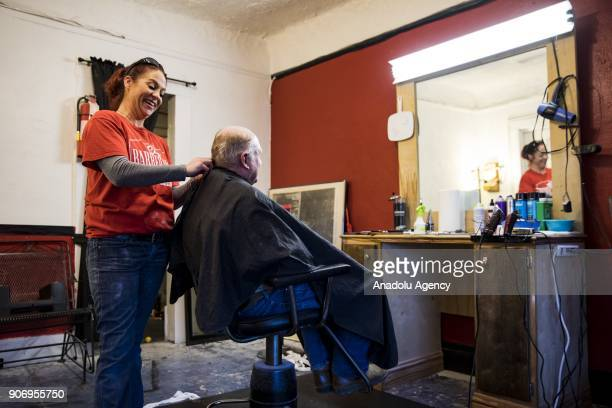 George Hopsson gets his hair cut in a small barber shop in Wetumpka, Alabama, United States on January 09, 2018.