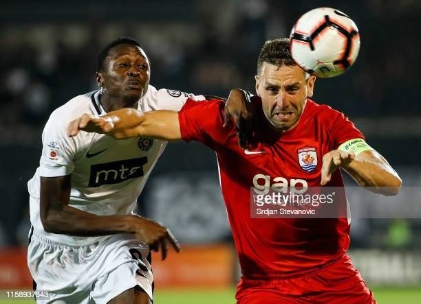 George Horan of Connah's Quay competes for ball against Umar Sadiq L) of Partizan the UEFA Europa League Second Qualifying round Second Leg match...