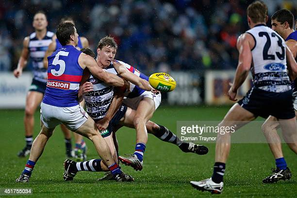 George Horlin-Smith of the Cats is tackled during the round 16 AFL match between the Geelong Cats and the Western Bulldogs at Skilled Stadium on July...