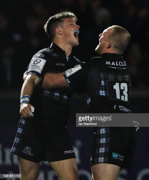 George Horne of Glasgow Warriors celebrates with Nick Grigg after he scores his team's fifth try during the Champions Cup match between Glasgow...