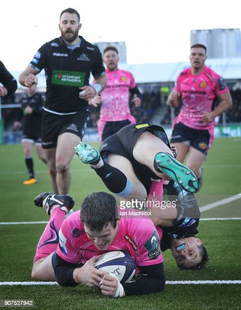 George Horne of Glasgow Warriors fails to stop Ian Whitten of Exeter Chiefs scoring his team's third try during the European Rugby Champions Cup...
