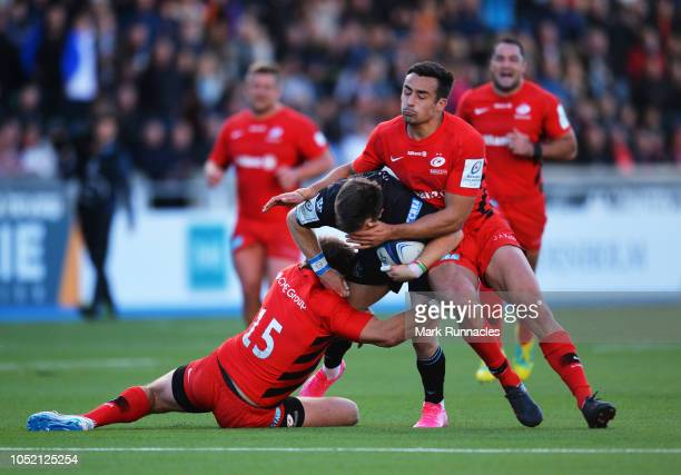 George Horne of Glasgow Warriors is tackled by Alex Goode of Saracens and Alex Lozowski of Saracens during the Champions Cup match between Glasgow...