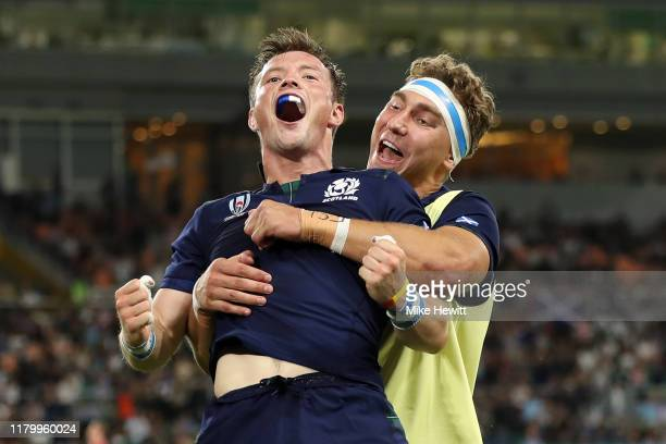 George Horne of Scotland celebrates scoring his team's seventh try with Jamie Ritchie of Scotland during the Rugby World Cup 2019 Group A game...