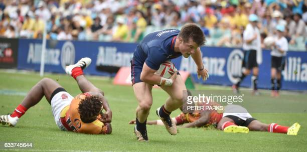 George Horne of Scotland out runs Papua New Guinea players to score a try in their pool C match at the Sydney Sevens World Series tournament in...
