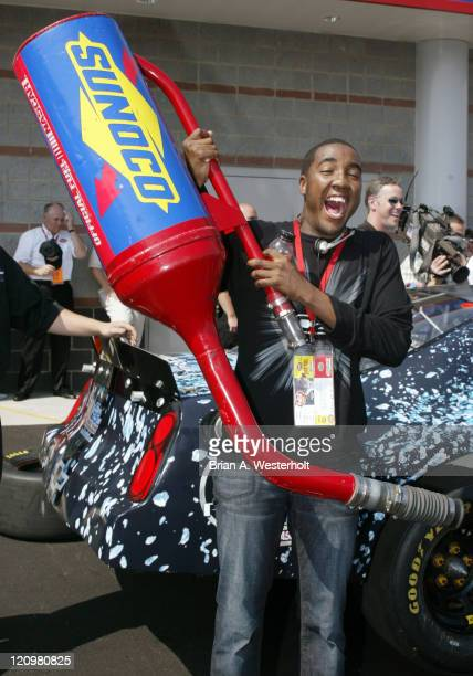 George Huff American Idol contestant shows off his strength by lifting a Sunoco gas can during a pit stop demonstration prior to the CocaCola 600 at...