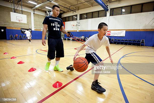 George Huynh right practices drills with coach Vinh Bui of Masae basketball at the Dorchester House MultiService Center Johnny and George Huynh after...