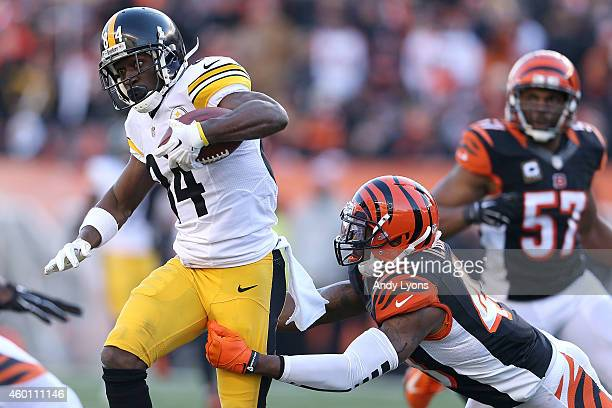 George Iloka of the Cincinnati Bengals attempts to tackle Antonio Brown of the Pittsburgh Steelers during the third quarter at Paul Brown Stadium on...