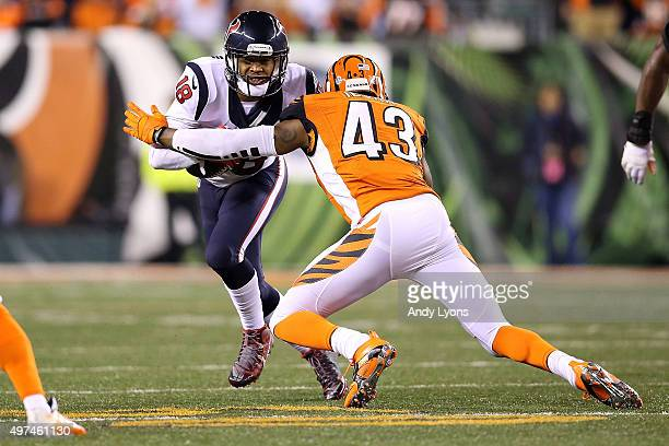 George Iloka of the Cincinnati Bengals attempts to tackle Cecil Shorts III of the Houston Texans during the third quarter at Paul Brown Stadium on...