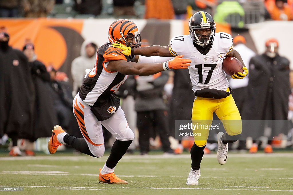 George Iloka #43 of the Cincinnati Bengals attempts to tackle Eli Rogers #17 of the Pittsburgh Steelers during the fourth quarter at Paul Brown Stadium on December 18, 2016 in Cincinnati, Ohio. Pittsburgh defeated Cincinnati 24-20.