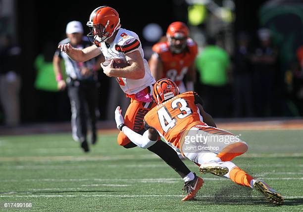 George Iloka of the Cincinnati Bengals attempts to tackle Kevin Hogan of the Cleveland Browns during the third quarter at Paul Brown Stadium on...