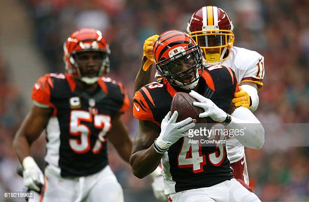 George Iloka of the Cincinnati Bengals intercepts a pass during the NFL International Series game against the Washington Redskins at Wembley Stadium...