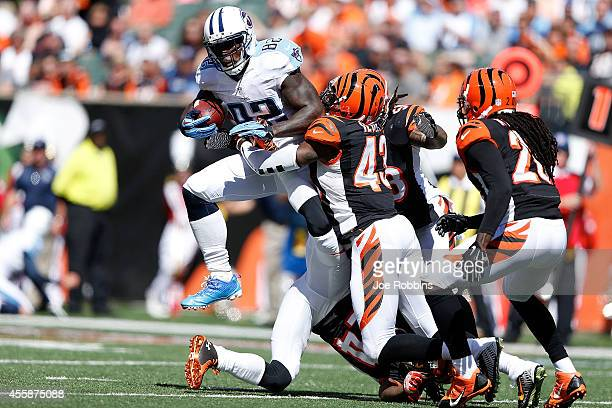 George Iloka of the Cincinnati Bengals tackles Delanie Walker of the Tennessee Titans during the second quarter at Paul Brown Stadium on September 21...