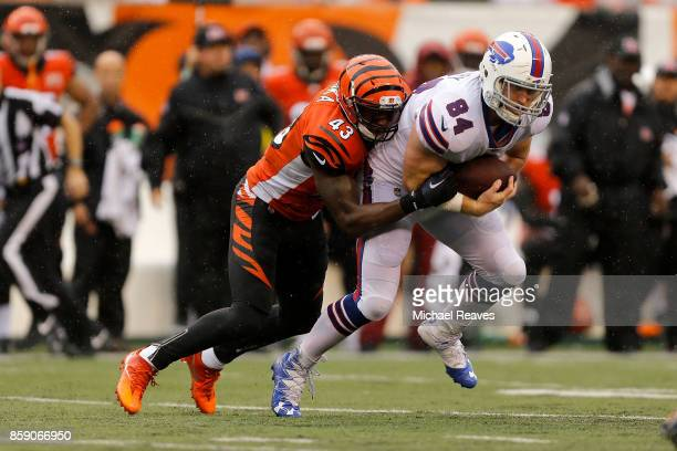 George Iloka of the Cincinnati Bengals tackles Nick O'Leary of the Buffalo Bills during the second quarter at Paul Brown Stadium on October 8 2017 in...