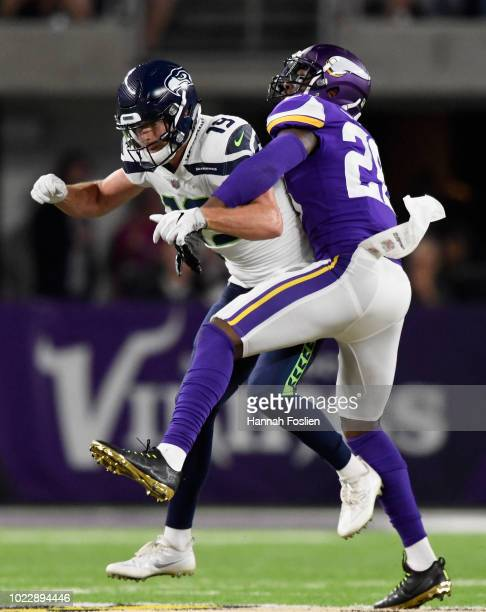 George Iloka of the Minnesota Vikings breaks up a pass intended fro Tanner McEvoy of the Seattle Seahawks during the fourth quarter in the preseason...